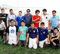 Juan Carlos Argüello con los jugadores ciegos del NEA