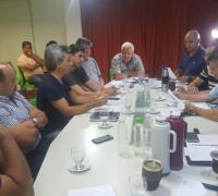 Directivos de la Federción y funcionarios provinciales encabezados por el gobernador Peppo