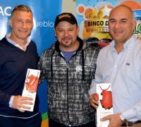 Carlos Verza con el presdiente y vocal de Lotería, Brugnoli y Núñez